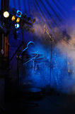 Drummer. Playing during concert on stage stock image