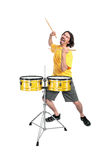 Drummer. Happy young drummer with drumsticks isolated over white Stock Image