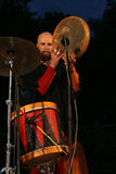 Drummer. Musician in ethnic costume beating the drums Stock Photos