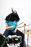 Drummer. Woman flipping hair feeling the music and play drum kit,check also Musical instruments and musicians Royalty Free Stock Photography