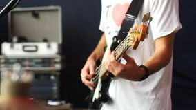 Drummer and Bassist plays bass guitar. On a stage. 4K Slowmo stock video footage