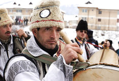 Drummer from Bear dance parade. The parade take place every winter in Moldavia area, eastern Romania Stock Photo
