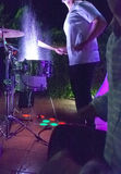 Drummer beating and splashing drums at night show Royalty Free Stock Image