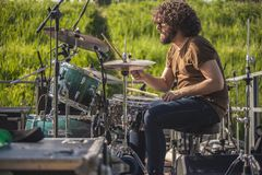 Drummer beats on the drums. During a live concert stock photos