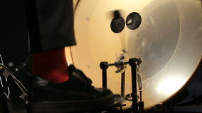 Drummer beats the rhythm into the bass drum with pedal stock video