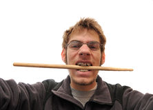 Drummer biting his drumstick Royalty Free Stock Images