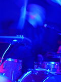 Drummer in blurred motion playing drum set Royalty Free Stock Images