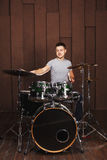 Drummer on a brown background Royalty Free Stock Photos
