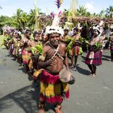 Drummer and dancer on Sepik River in New Guinea Royalty Free Stock Images
