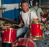 Drummer drifting away at the rhythm Royalty Free Stock Images