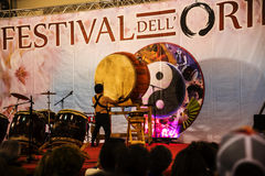 Drummer at the Festival of the Orient in Rome Italy. The Festival of the Orient was held at the Exhibition Centre near Rome Airport at Fumincino on the outskirts Royalty Free Stock Image