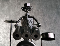 Drummer figure made of metal parts. A drummer figure made of all sorts of metal parts, such as bolts, screws and other industrial parts. The figure is against Stock Photo