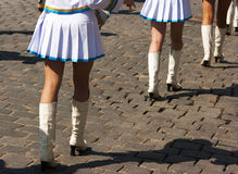 Drummer girls legs on city day Royalty Free Stock Image
