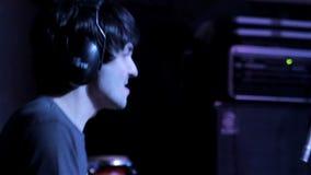 Drummer with headphones closeup stock video