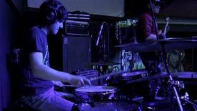 Drummer with headphones stock video