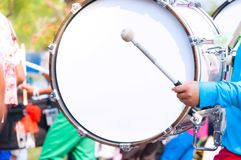 Free Drummer In Blue Uniforms A Marching Band. Drummer Plays Big Drum In Parade Stock Photography - 154098882