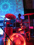 Drummer Jerome James jams on drums with trippy video show overh. HONOLULU - APRIL 25:  Drummer Jerome James jams on drums with trippy video show overhead in club Royalty Free Stock Image