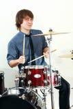 Drummer man. Playing on drums studio shot stock images