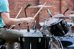 Drummer man playing on drums Royalty Free Stock Photo
