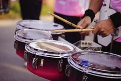 Drummer marching in Annual sports event parade.  royalty free stock photography