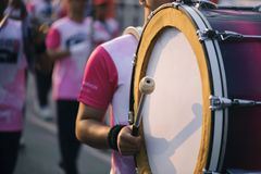 Drummer marching in Annual sports event parade.  royalty free stock photos