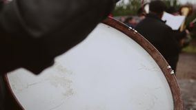 The drummer in the orchestra performs the part on the bass drum. View of the beater. Close-up of a drummer`s shoulder stock video footage