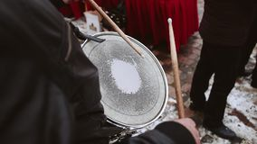 The drummer in the orchestra plays on the lead drum. The drum hangs on the neck. The view from behind the barbler`s shoulder on the working surface of the drum stock footage