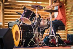Drummer performing on stage at live concert. Royalty Free Stock Image