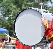 Drummer Playing Bass Drum in Parade Stock Images