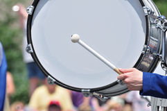 Drummer Playing Bass Drum in Parade Royalty Free Stock Image