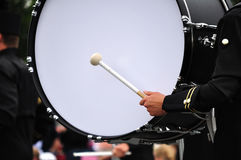 Drummer Playing Bass Drum in Parade. Copy Space Stock Photo
