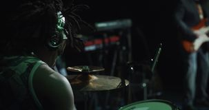 Drummer playing at the concert stock footage