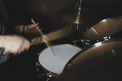 Drummer playing a drum kit stock photo