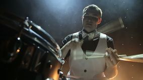 Drummer playing the drums. With smoke in the background stock footage