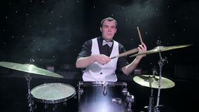 Drummer playing the drums. With smoke in the background stock video footage