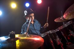 Drummer playing the drums with smoke Stock Photos