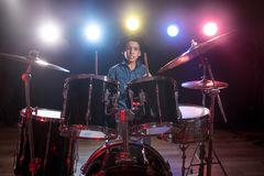Drummer playing the drums with smoke Stock Photo