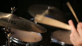 Drummer playing the drums. In a studio on dark background stock video footage