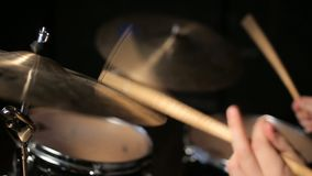Drummer playing the drums. In a studio on dark background stock footage