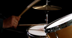 Drummer playing his drum kit Royalty Free Stock Photography