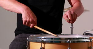 Drummer playing his drum kit Stock Photography