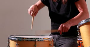 Drummer playing his drum kit Royalty Free Stock Image