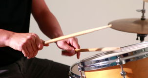 Drummer playing his drum kit Stock Photo
