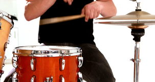 Drummer playing his drum kit Stock Photos