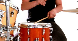 Drummer playing his drum kit Royalty Free Stock Images