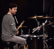 Drummer. Playing live on stage Stock Images