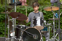 Drummer. Playing live on stage during daylight Royalty Free Stock Photo