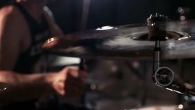 Drummer playing plates on concert close up stock footage