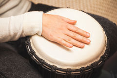 Drummer plays on African drum. Closeup photo with selective focus Stock Photography