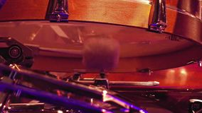 Drummer plays on a bass drum with pedal stock footage